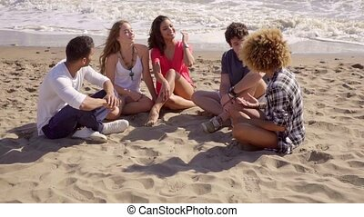 Group Of Young People - Group of young people sitting on the...