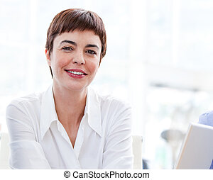 Self-assured businesswoman at work - Portrait of a...