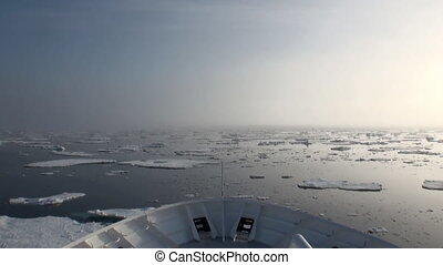 Dawn in ocean among icebergs and ice in Arctic - Dawn in the...