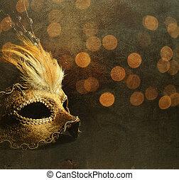 Venetian Mask - Golden venetian mask over shiny bokeh...