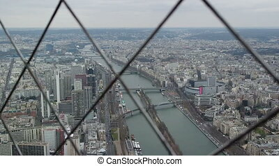 PARIS, FRANCE - MARCH 23, 2016: Top view of Paris city from the Eiffel Tower. Seine River view from upper balcony