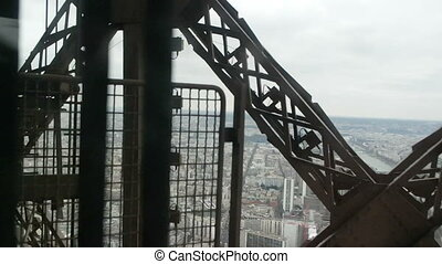 View of Paris from moving Eiffel Tower Lift