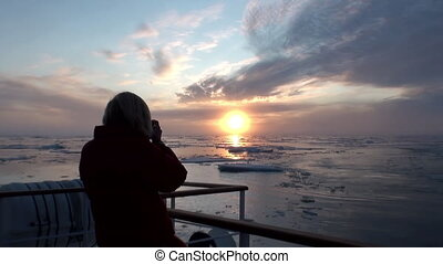 Sunset in ocean among icebergs and ice in Arctic. - Sunset...