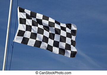 checkered flag - end of race checkered flag waving in the...