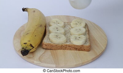 Healthy whole wheat bread with banana and honey, stock video