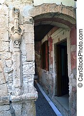 Old portico in stones. - Old portico in stones with a...