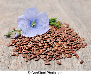 Flax seeds with flowers close up