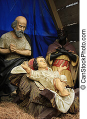 Christmas nativity scene with baby Jesus, Mary Joseph in...