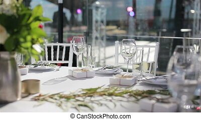 Glasses on white cloth table served