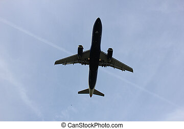 Plane approaching runway - Commercial airplane approaching...