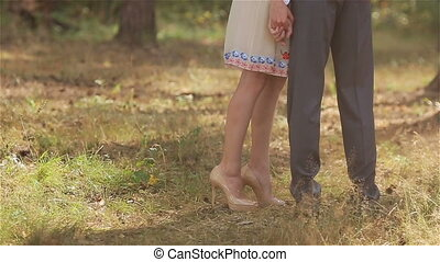 Woman high heels embrace man forest - Young woman on high...