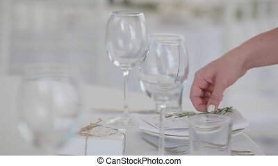 Waiter hand arranging table setting - Catering job...