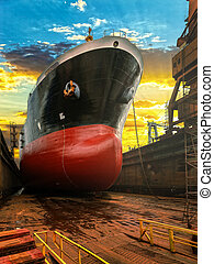 Ship bow at sunrise - Big ship during repairs on dry dock in...