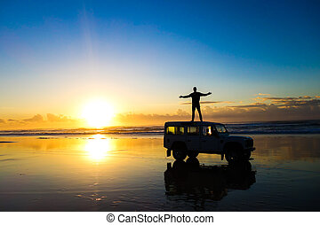 Car on the beach on sunrise - Sunrise in Fraser Island,...