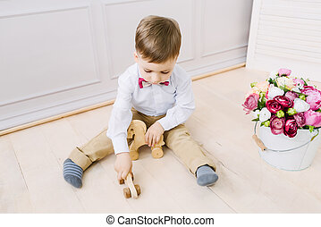 Boy playing while sitting on the floor