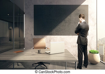 Thoughtful man and chalkboard - Thoughtful businessman in...