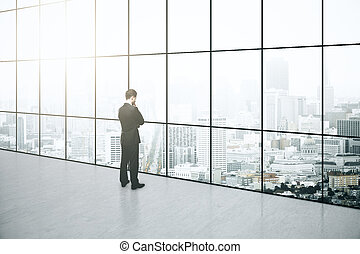 Thoughtful businessman in interior - Thoughtful businessman...