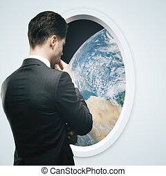 Businessman and light spaceship window - Thoughtful...