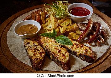 Assorted fried sausages, grilled potatoes, sauce Adjika,...