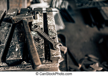 Industrial tools in old factory, metal table with mechanic...