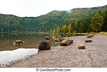 Saint Anna lake on a cloudy day - Autumn landscape at Saint...