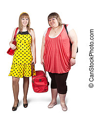 casual girls with travelling bag - Two casual girls with...