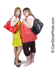 casual girls with handbags - Two happy casual girls with...