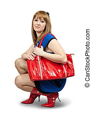 woman holding a purse - Girl in blue dress ang red high...