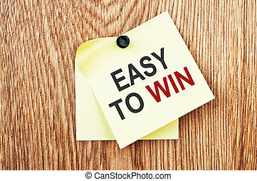 Easy to Win Message written on a note paper