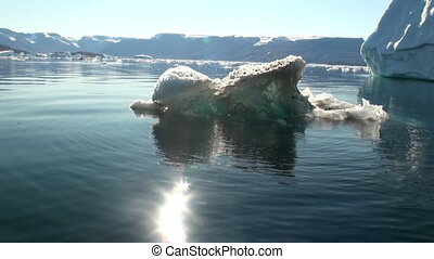 Small Iicebergs floating in sea around Greenland - Small...