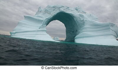 Iceberg arch like Darwin arch in Galapagos Islands....