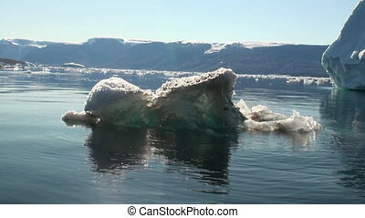 Small Iicebergs floating in sea around Greenland. - Small...
