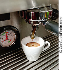 Espresso machine making a cup of coffee - Close up of an...