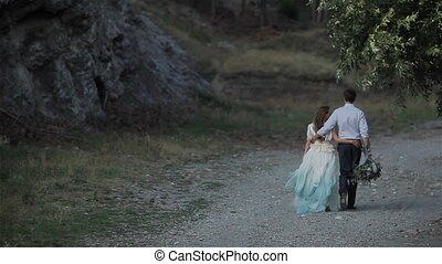 Man woman back walk road together - Unrecognizable man and...