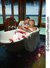 Lovely bride and groom during dream preparation and spa...