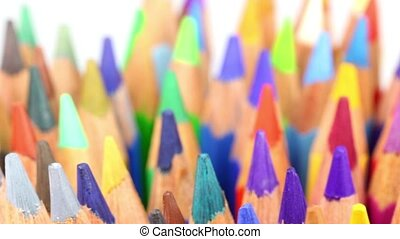 Crayons are spinning around - Multicolored crayons are...