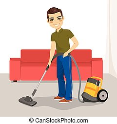 Man Vacuum Cleaner - Young man using vacuum cleaner on his...