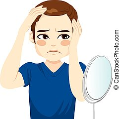 Male Worried Hair Loss - Male looking in a mirror worried...