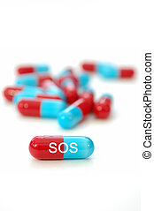 SOS pills - Macro of the word SOS labelled on a pill
