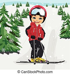 Little boy wearing red ski jacket and a helmet skiing in the ski resort