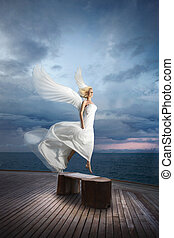 Ethereal, divine, unreal bride lfly like a bird from ocean...