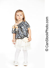 Little girl in a fashionable clothes