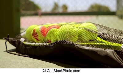 Number of tennis balls on a racket for training - Number of...