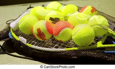 Net bag of tennis balls for training on a racket - Net bag...