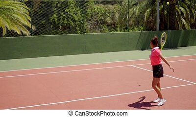 Angry young woman tennis player yelling and calling for a...