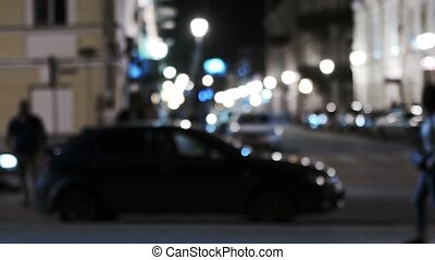Out of focus shot of a city scene at night with fancy lights...