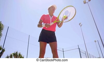Player preparing to serve tennis ball - Low angle view on...