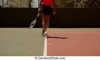Young woman standing on the baseline on an outdoor all...