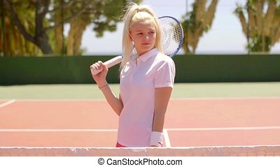 Attractive active blond woman playing tennis - Attractive...