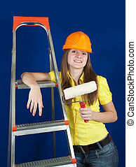 female painter - female house painter with paint rollers...